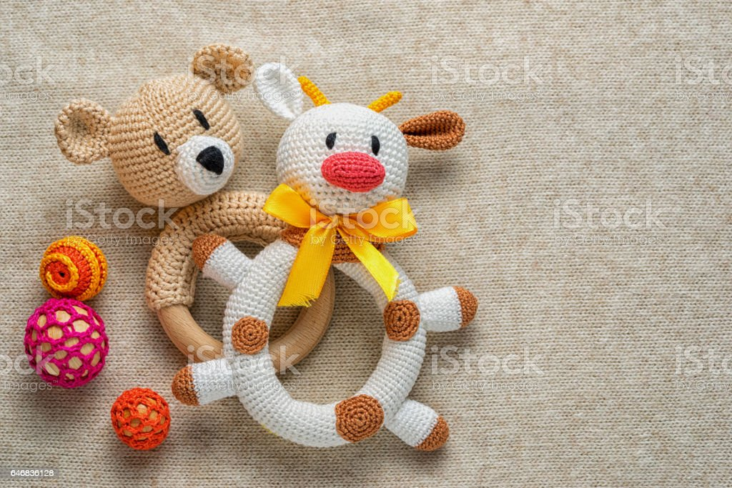 knitted rattles for toddlers and copy space. stock photo