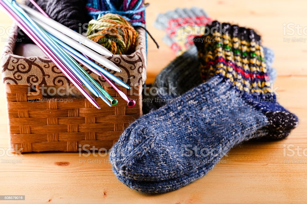 Knitted socks next two box with other accessories stock photo