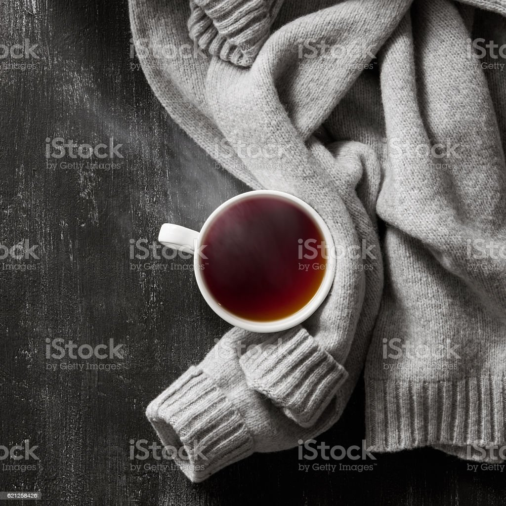 knitted sweater with to cup of tea stock photo