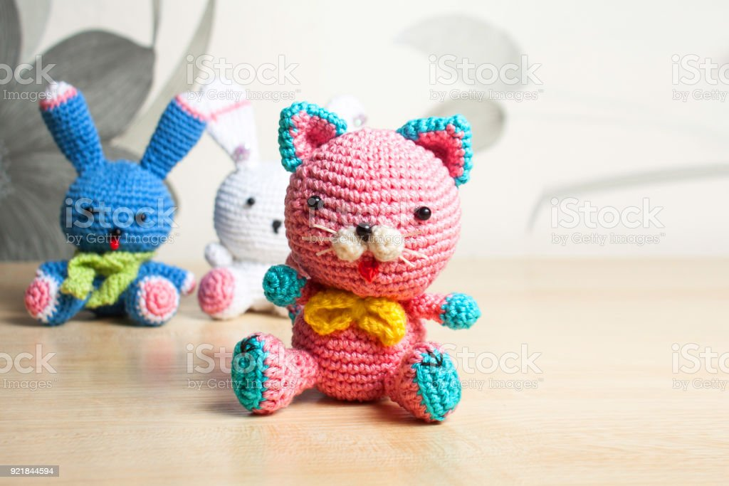 knitted toy cat, bear, rabbit, hare, handmade on the table