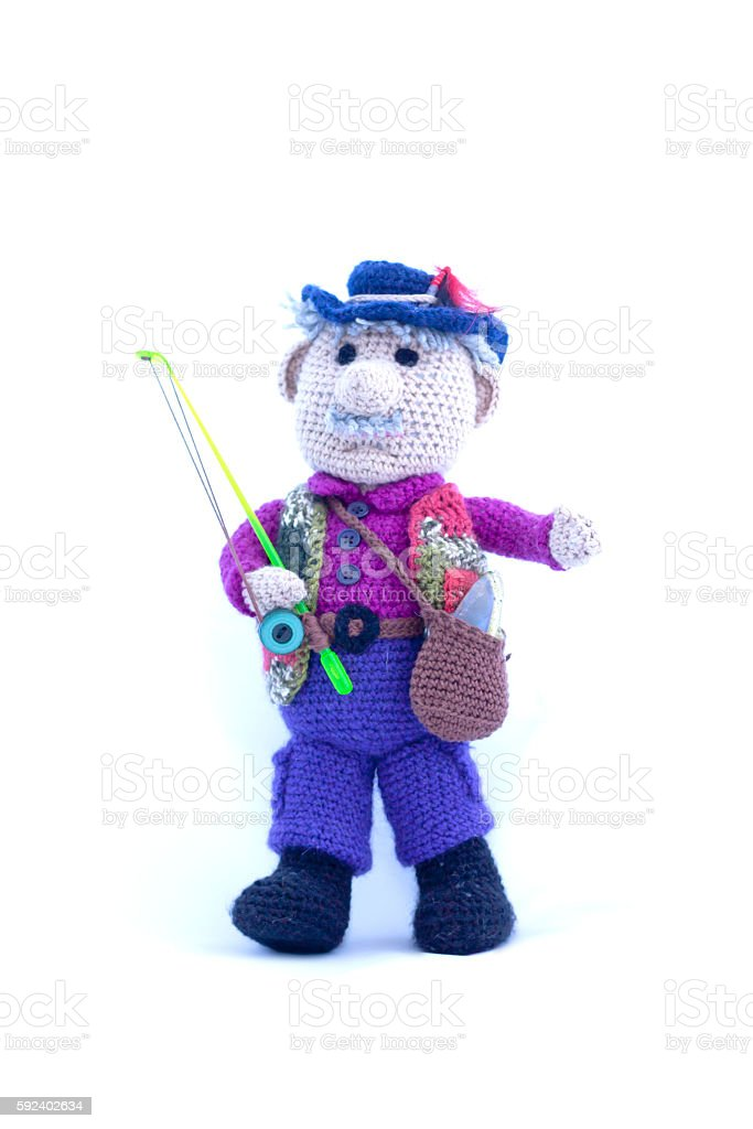 Knitted toy fisherman on white background - foto de stock