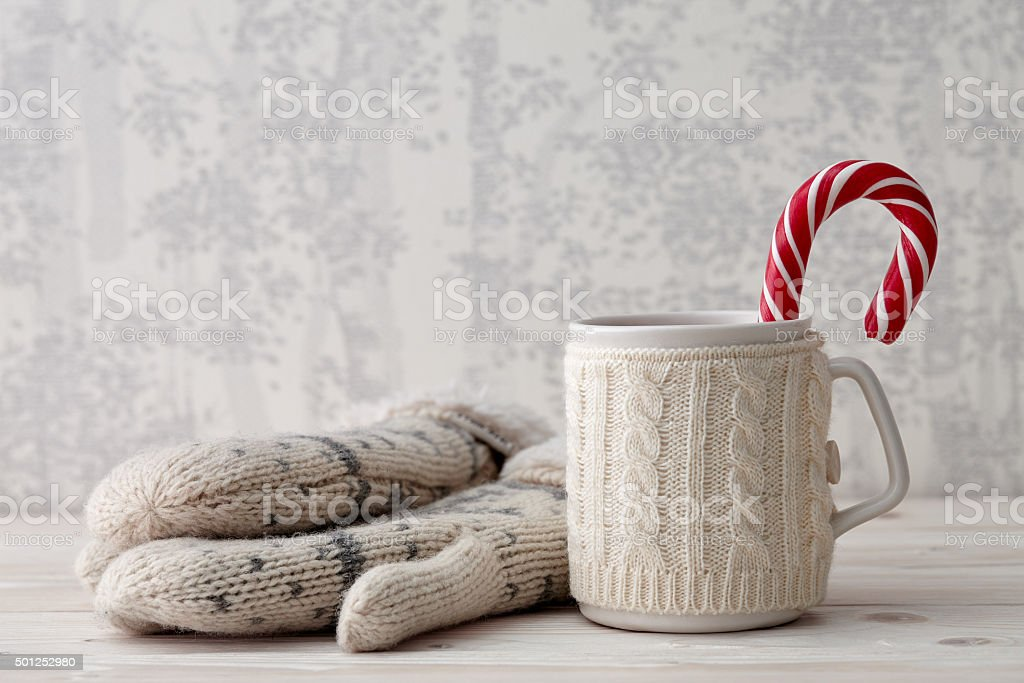 Knitted winter cup with candy cane stock photo