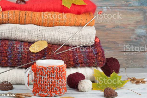 Knitted wool sweaters pile of knitted winter autumn clothes on red picture id691461022?b=1&k=6&m=691461022&s=612x612&h=gwx093hd2ncq kw8dd3jmfg xceddnelscf8pre sek=