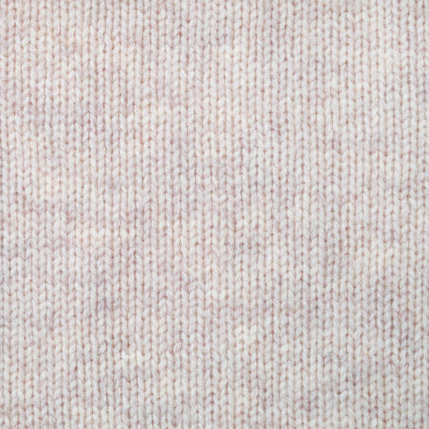 Knitted woollen texture background. Plain knitting stock photo