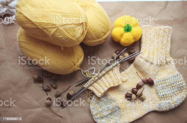 Knitted yellow socks balls of yarn and knitting needles nearby yellow picture id1195686015?b=1&k=6&m=1195686015&s=612x612&h=wckprjqh9hoth4 rjwcg3belocbbl17kfnxj 3lddh8=
