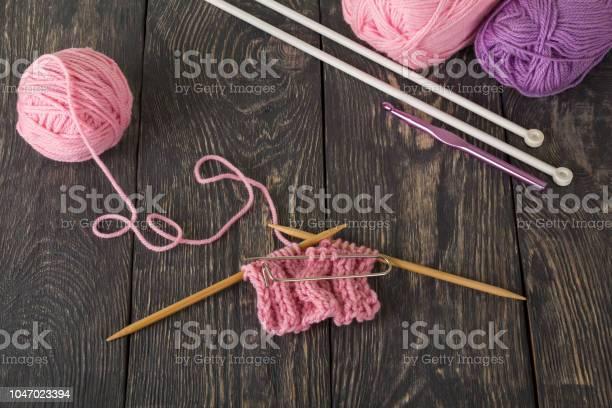 Knitting a pink scarf mixed yarn on dark boards picture id1047023394?b=1&k=6&m=1047023394&s=612x612&h=ix5ga utgi8gdeujrtmwt7hlmaqbu9fdfxubzm5c2gq=