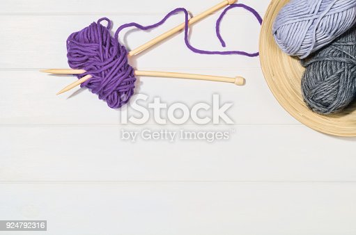 istock Knitting accessories top view on white wooden background 924792316