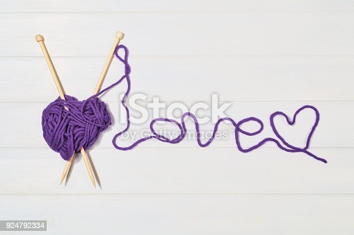 istock Knitting accessories top view on white wooden background 924792334