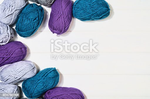 istock Knitting accessories top view on white wooden background 924792368