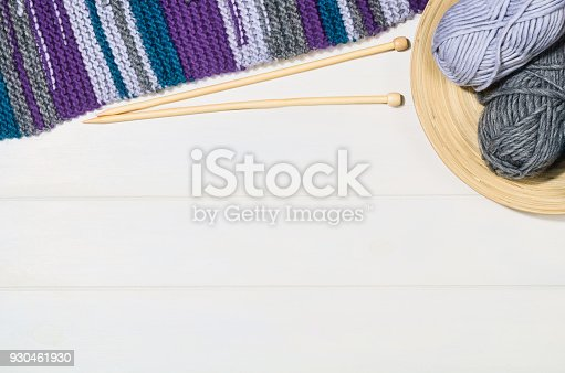 istock Knitting accessories top view on white wooden background 930461930