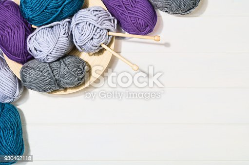 istock Knitting accessories top view on white wooden background 930462118