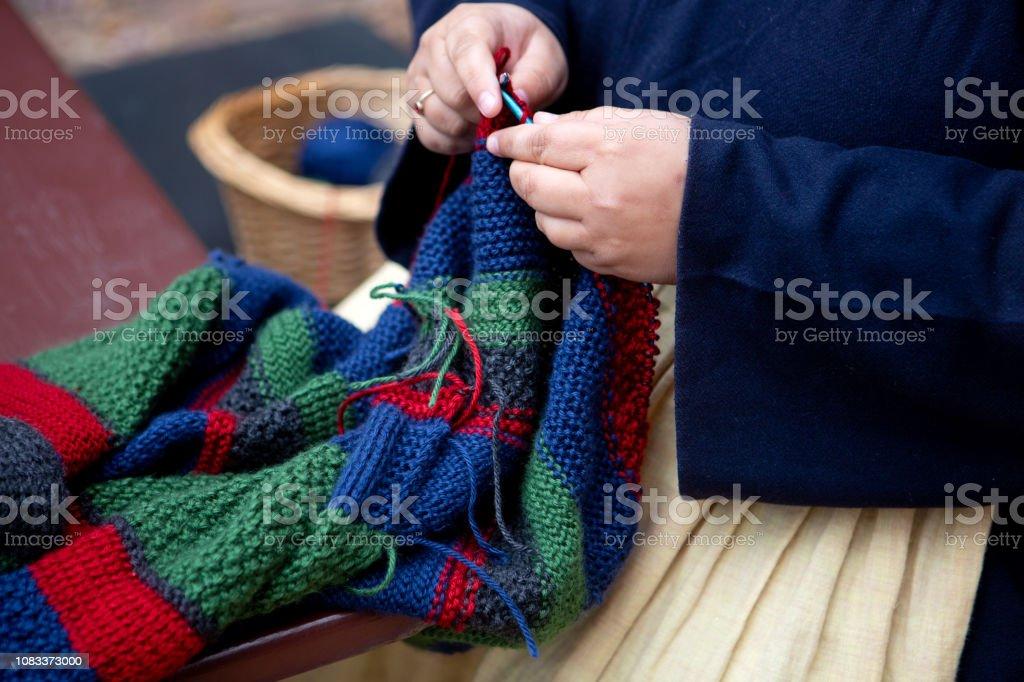 knitting an afghan stock photo