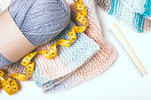 Knitting at your leisure. Crochet hooks, yellow centimeter and inch tape tailor. Knitting pattern. Top view.