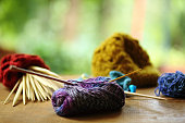 Close shot of yarn, knitting and crochet accessories.