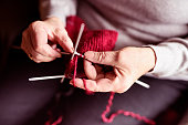 Close-up of knitting hands, senior woman
