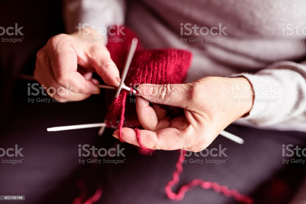 Knitting hands of senior woman stock photo