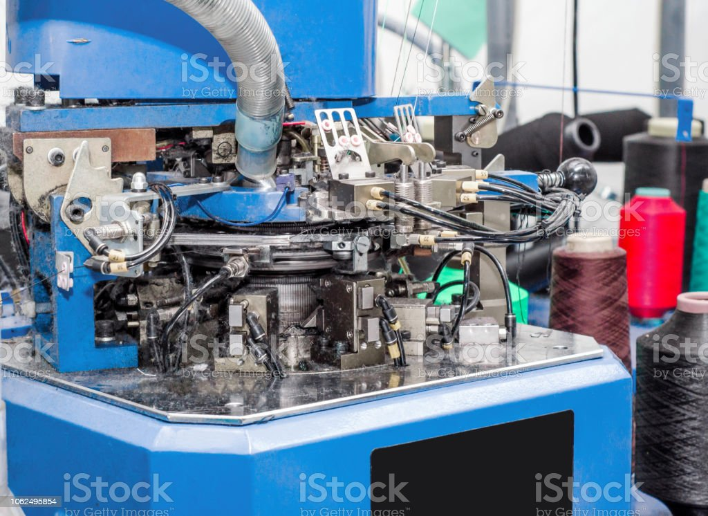 knitting machine for making socks threads parts production of picture id1062495854