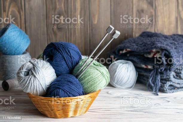 Knitting materials blue and green yarn in a basket with needles on picture id1179345690?b=1&k=6&m=1179345690&s=612x612&h= lt0bxxhaegdh clvxb2x2zqmflev9kxu2zrzu9r2ok=