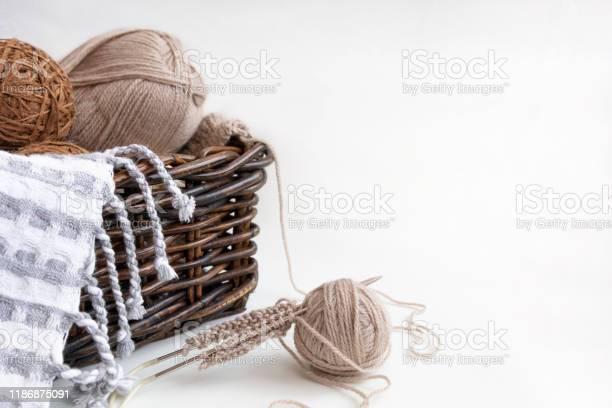 Knitting needles and balls of yarn gray and brown wool yarn in wicker picture id1186875091?b=1&k=6&m=1186875091&s=612x612&h=9mvwlv4upv9ew01sdz0muunm1wybaadituniz 1vc7s=