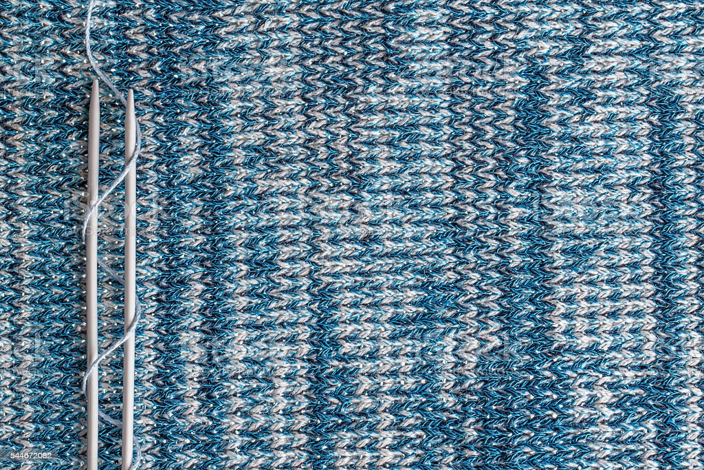 knitting needles on a background associated texture of yarn стоковое фото