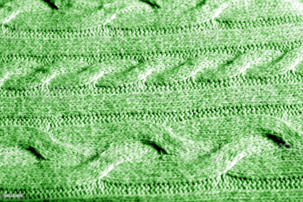 Knitting pattern in green color. royalty-free stock photo