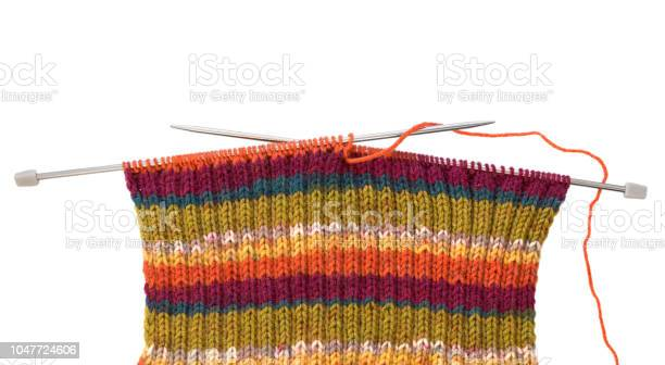 Knitting pattern on needles of woolen threads colorful isolated on picture id1047724606?b=1&k=6&m=1047724606&s=612x612&h=xp01ifws733xe50k8x4sarb0rmkdgyxwkcvh dhl8xi=