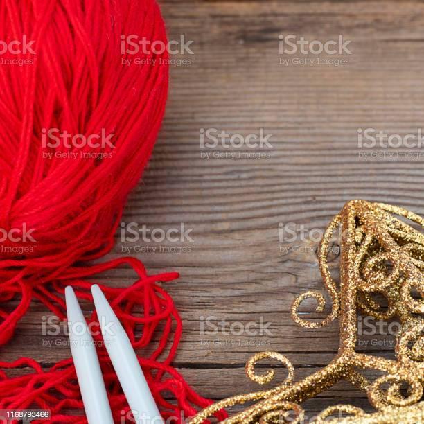 Knitting sticks red yarn and yellow christmas decoration on old picture id1168793466?b=1&k=6&m=1168793466&s=612x612&h=5ziofva1mvfmp1k6utsrfrguwlndtdh482hwdbnzyty=