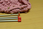 knitting tool on brown wooden table