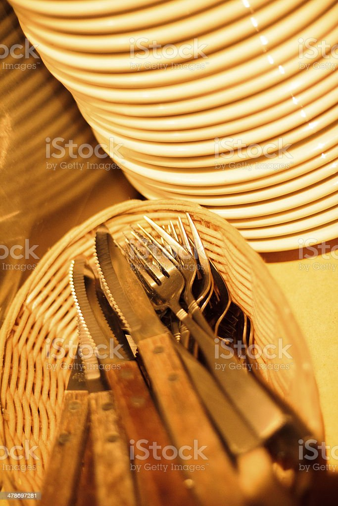 Knives, Forks, and Stacked Plates royalty-free stock photo