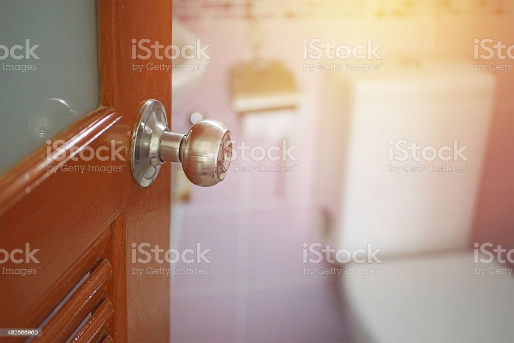 knob with opened door and blur toilet stock photo