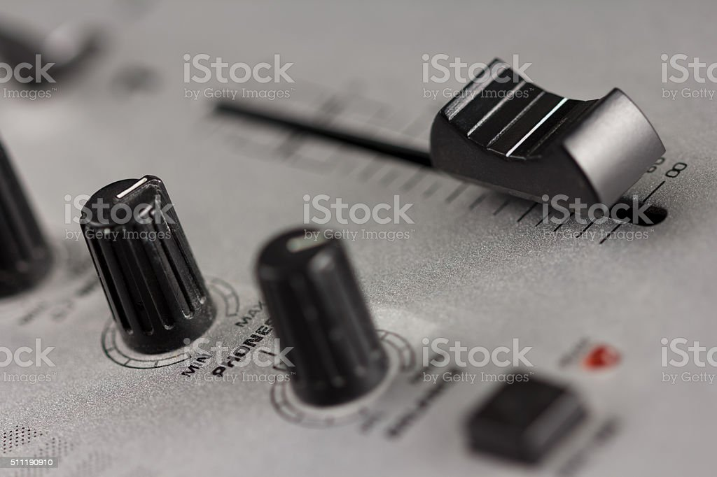 Knobs and fader of a DJ mixer stock photo