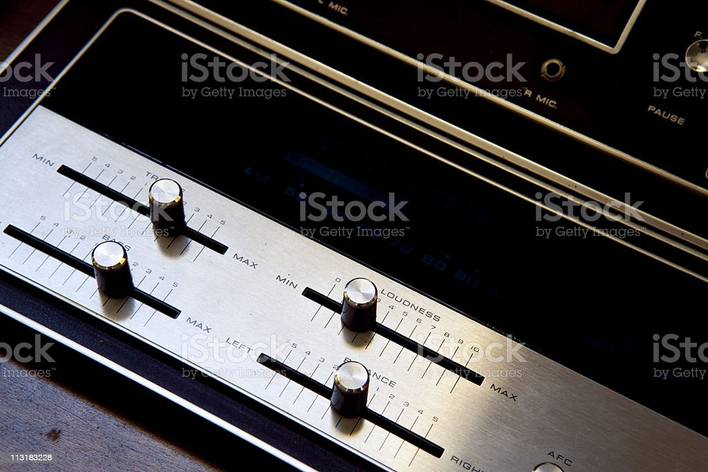 Knobs on a vintage stereo royalty-free stock photo
