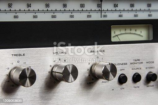 knobs on the amplifier, treble, volume, balance.