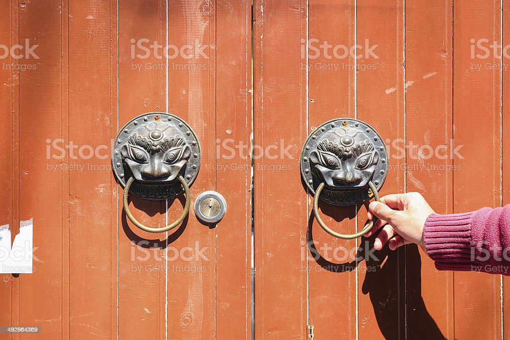 knock at the old wooden door stock photo