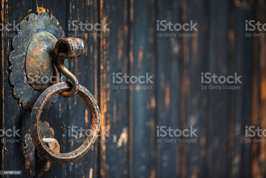 knocker on old wooden door stock photo