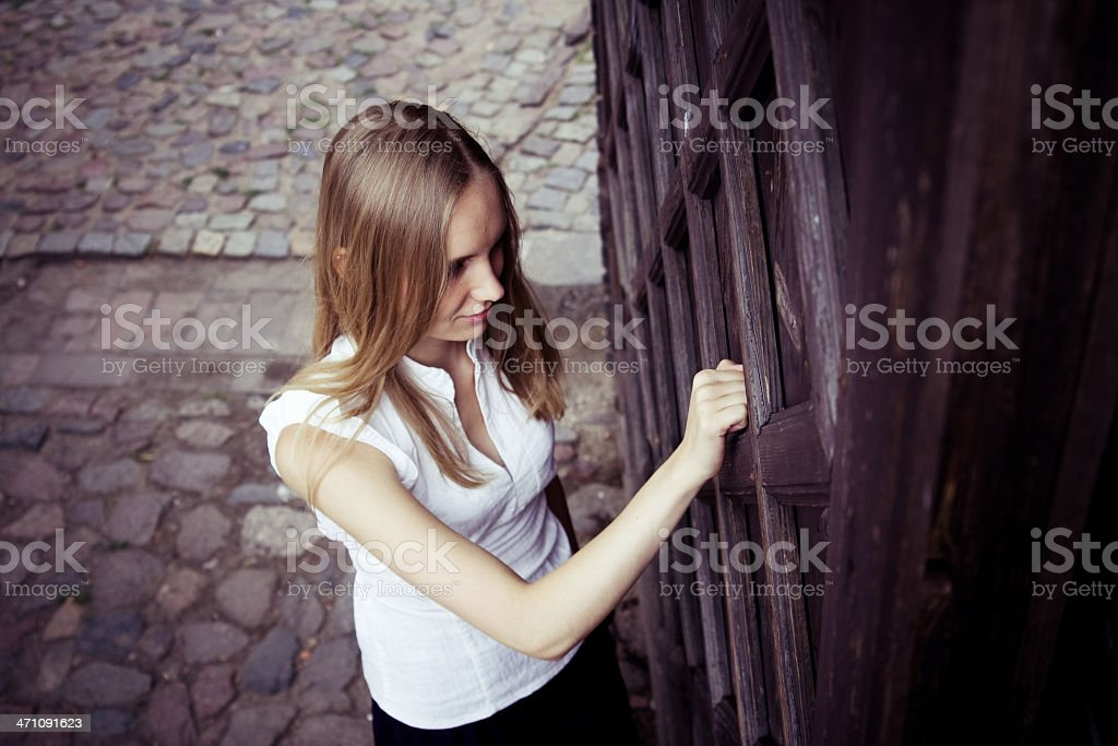 knocking on an old wooden door royalty-free stock photo