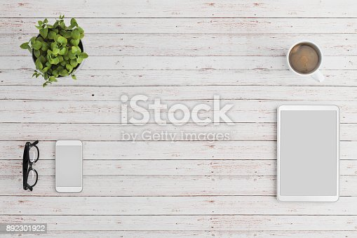 istock Knolling business desk top view with blank tablet and smartphone 892301922