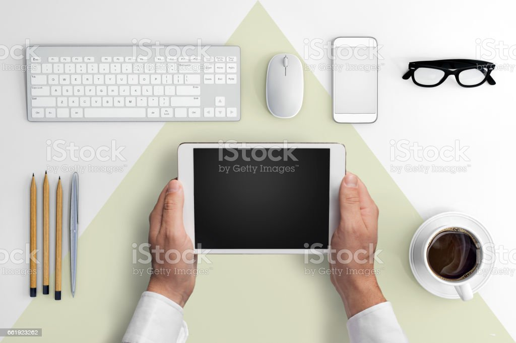 Knolling business hipster man holding tablet stock photo