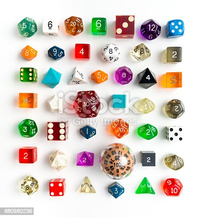 Large variety of various types of dies for gaming and chance in knelling arrangement