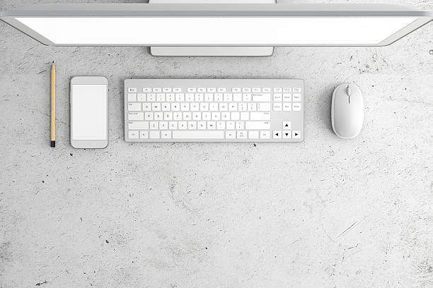 Knolling of an office desk Knolling top of an office desk with a computer pc monitor on the top of the image, with keyboard and a mouse, with blank smartphone on the left side. Bottom part of the image is left clean for additional design. Objects are white and gray with roustic table surface. Horizontal composition overhead projector stock pictures, royalty-free photos & images