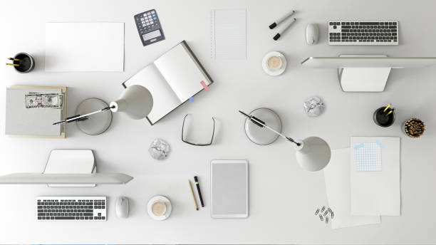 Knolling top view of a team office table Top knolling view of an office desk. business template. teamwork scene, with laptop, papers, notebook, tablet etc. creative mess designer background. mock up template. render messy home office stock pictures, royalty-free photos & images