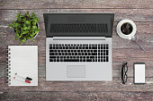 istock Knolling work table view with a laptop 636994386