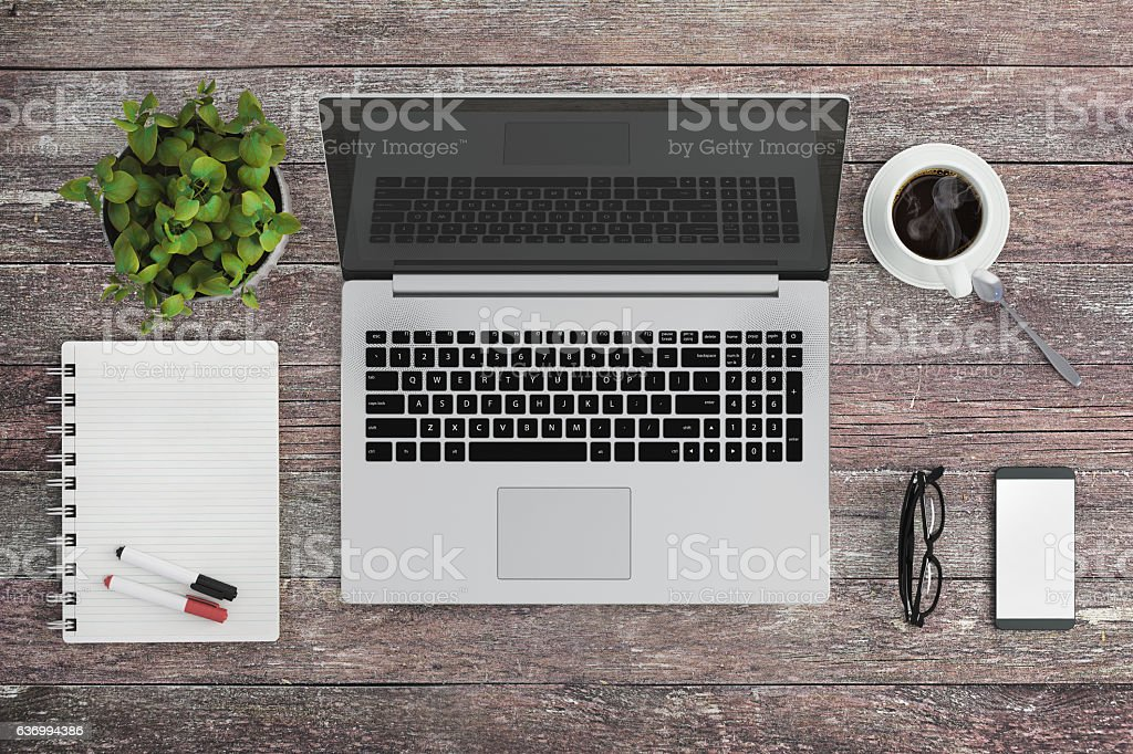 Knolling work table view with a laptop stock photo