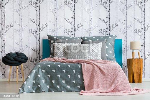 istock Knot cushion on stool 903314312