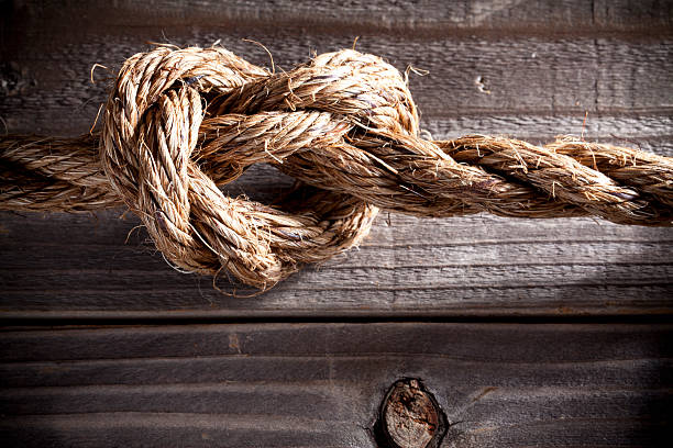 knot. love. tension. - knotted wood stock pictures, royalty-free photos & images
