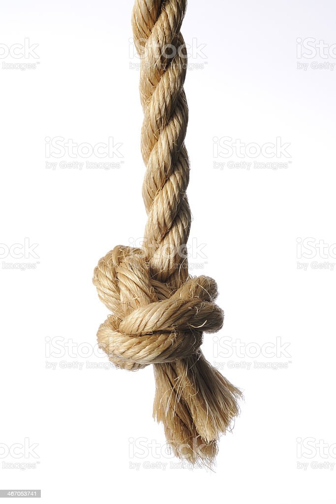 Knot on brown rope end against white background stock photo