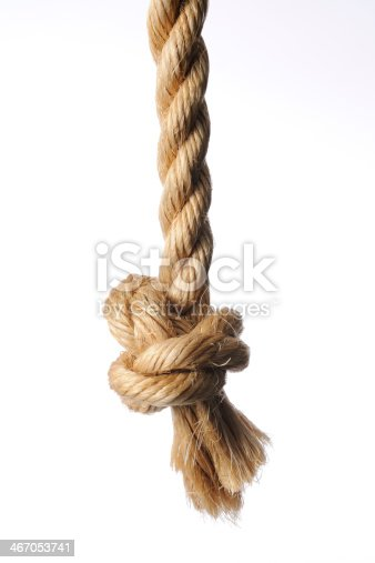 knot on brown rope end against white background stock