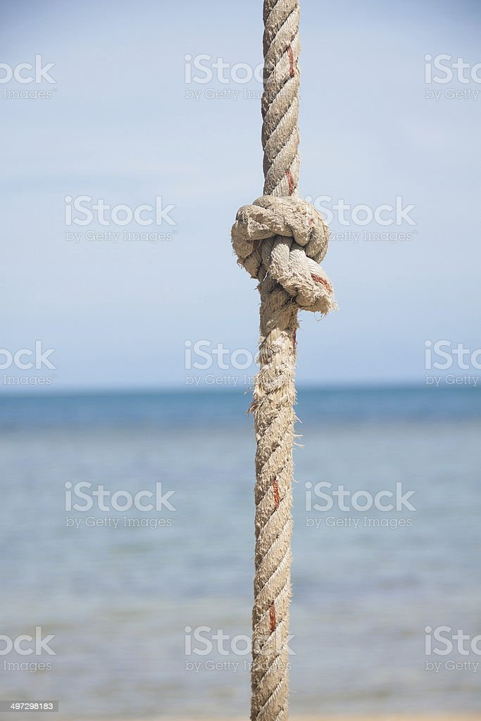 knot on the rope and sea royalty-free stock photo