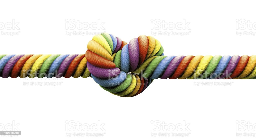 Knot tied in the center of a rope in LGBT rainbow colors stock photo