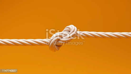 Knotted Rope on isolated Yellow Color Background
